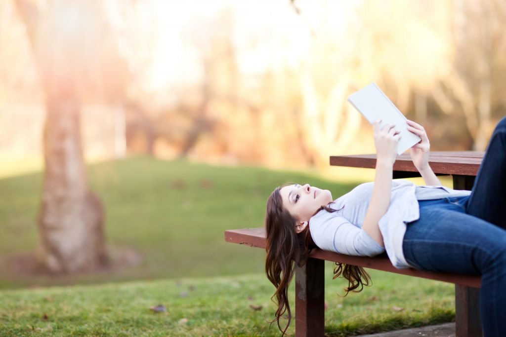 Happy Woman Reading in the Park Image